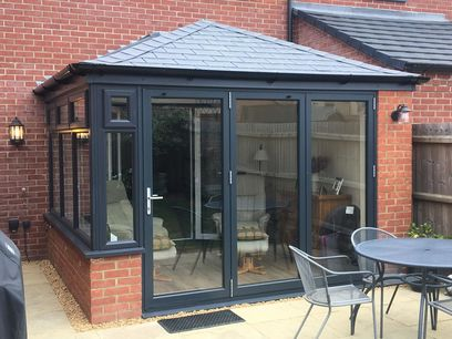 Solid roof conservatory with anthracite grey windows and doors, Northampton